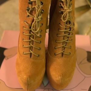 Reach for the sky!!! Jeffrey Campbell wedged boots